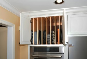 Pic9  Coastal beach house kitchen in white vertical storage above oven